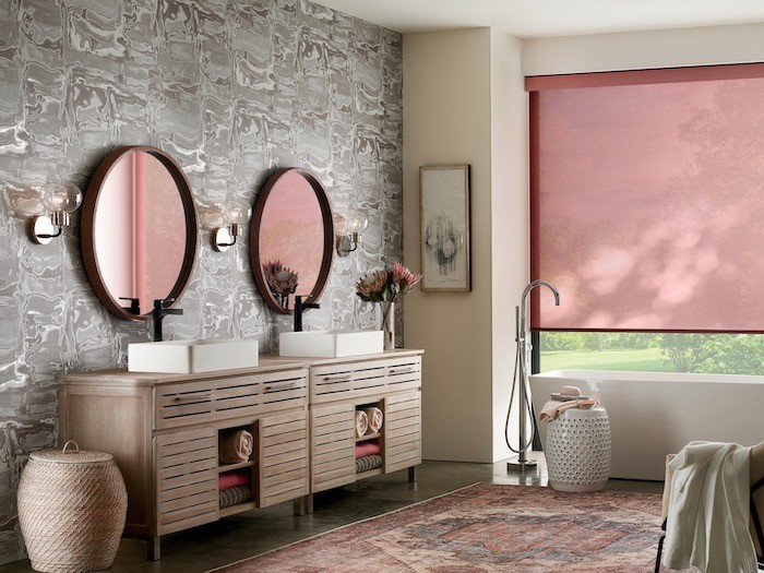 A bathroom with vintage wallpaper and modern furniture.